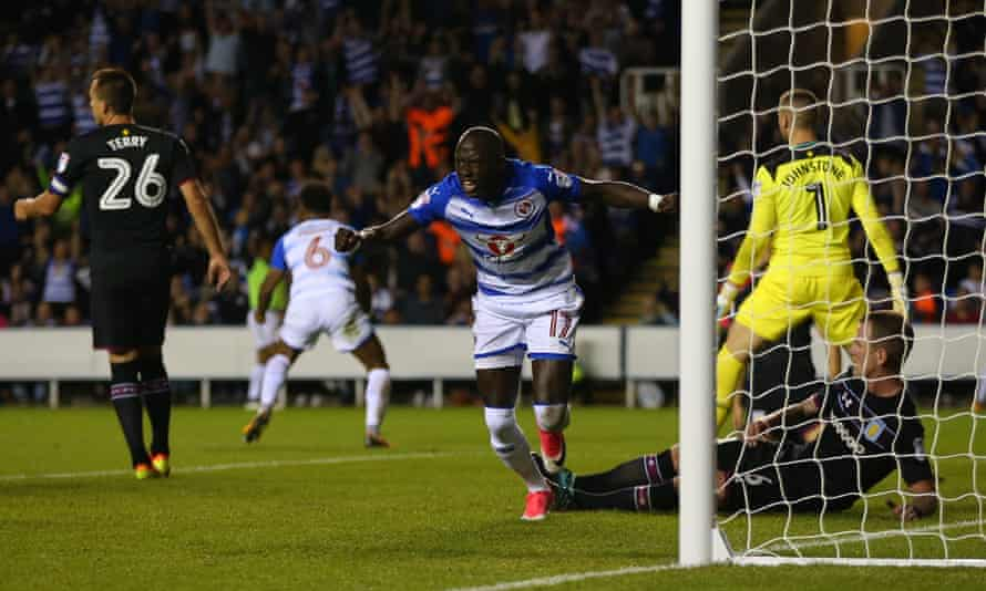 Modou Barrow celebrates after scoring Reading's second goal of the game.