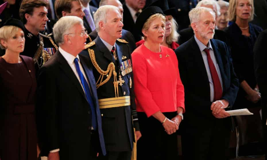 Jeremy Corbyn (right) stands as the national anthem is sung during the St Paul's Cathedral service.