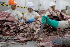 Employees prepare jerked beef at a plant of JBS S.A, in Santana de Parnaíba, Brazil 19 December 19 2017