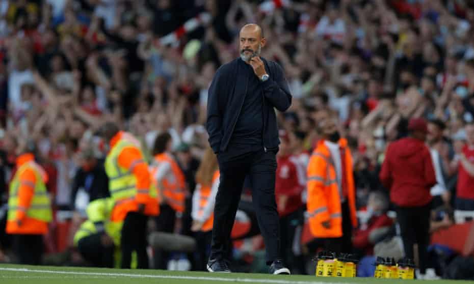 Nuno Espírito Santo walks off after his Tottenham side lost 3-1 against Arsenal at the Emirates Stadium.