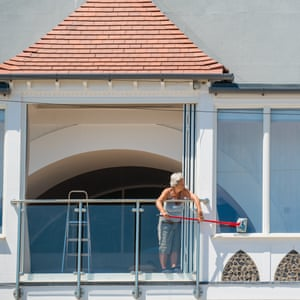 'This house has been in the family for 50 years' ... Jan cleans the windows of her Granville Marina home