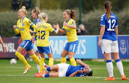 Brighton celebrate while Everton's Rikke Sevecke laments her own goal
