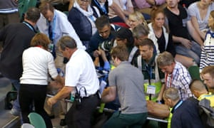 Nigel Sears, coach of Serbia's Ana Ivanovic, is carried on a stretcher from Rod Laver Arena during Ivanovic's third-round match against Madison Keys in the Australian Open.