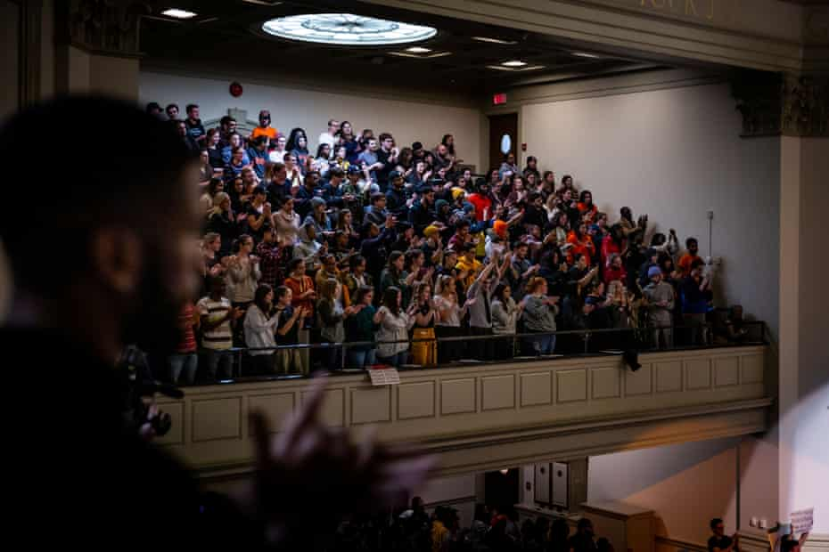 Students rally over dozens of racist incidents at Syracuse University in New York, on 20 November.
