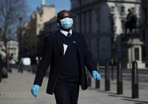 London, England A commuter wears a protective face mask and gloves on horse guards parade
