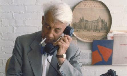 Sandberg at his desk at the Stedelijk Museum, c1960
