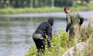 """A diver next to a canal in Ronquieres during a search for evidence in the """"Brabant's killers"""" case"""
