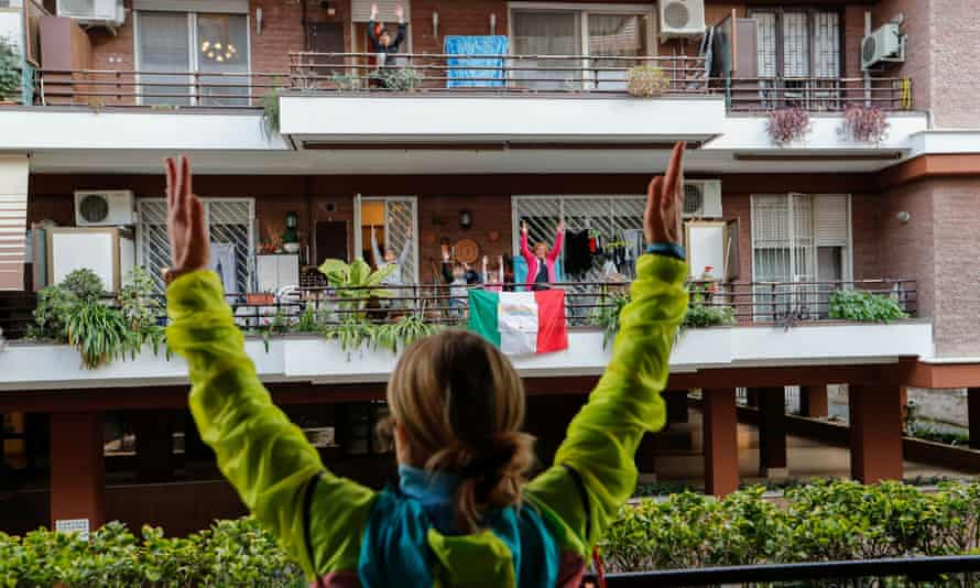 Personal trainer Antonietta Orsini, in March 2020, giving a class from the balcony for her neighbours in Rome.