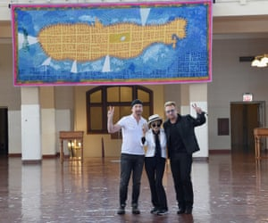 The Edge, Yoko Ono and Bono in front of the tapestry honouring John Lennon