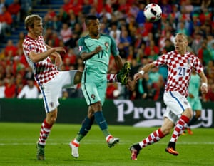Ivan Strinic, left, catches Nani as he attempts to hook the ball clear.
