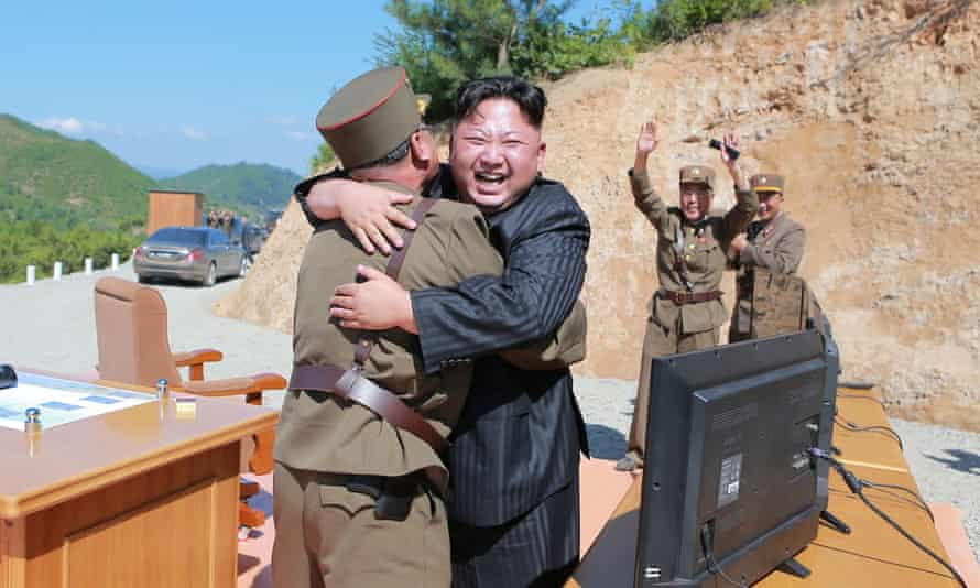 Kim Jong-un celebrates the test launch of North Korea's first intercontinental ballistic missile.
