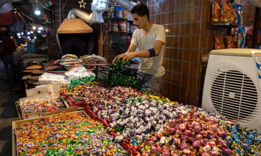 A stallholder selling sweets in Amman last week.