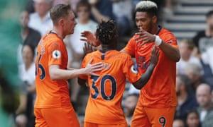 Joelinton, right, celebrates scoring for Newcastle.
