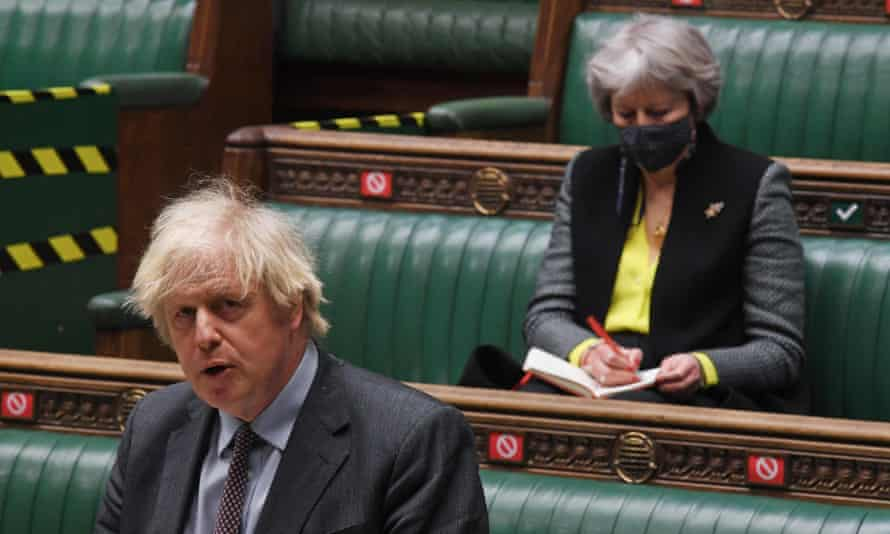 Theresa May listens to Boris Johnson in the House of Commons in February.