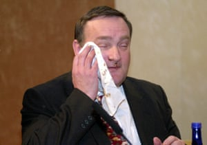 Agriculture minister Nick Brown wipes chocolate from his face