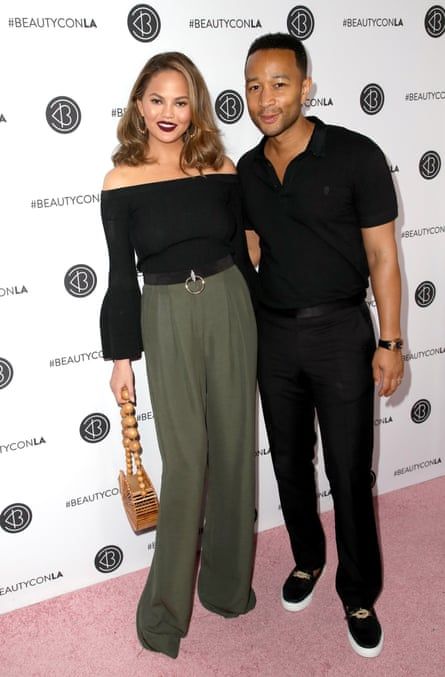 With his wife Chrissy Teigen.