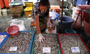 A Thai fresh fish-seller sorts shrimp at Klong Toey fresh food market in Bangkok. Allegations have been made that Thailand uses slave labor in the fishing industry.