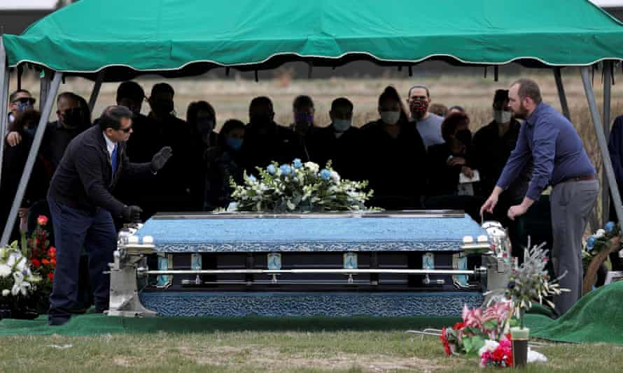 The coffin of Saul Sanchez, a meat packing plant employee, is lowered during his funeral after he died of Covid-19 in Greeley, Colorado, in April. The company said it was unclear where he caught the virus.