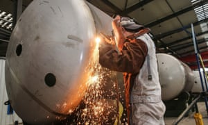 A worker welding a liquefied natural gas (LNG) tank at a factory in Nantong in China's eastern Jiangsu province.