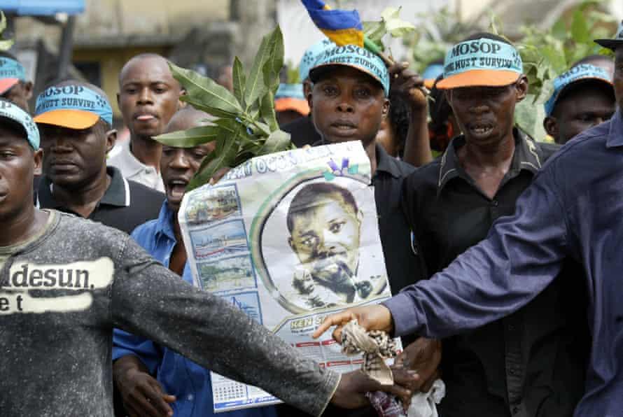 Protestors in Ogoniland march in memory of Ken Saro-Wiwa, executed on 10 November 1995