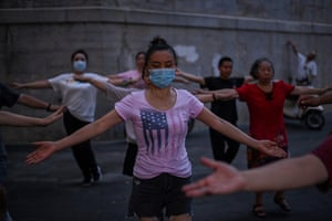 People dance next to the Yangtze river