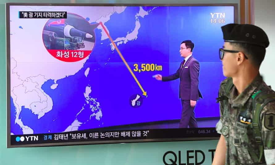 A news bulletin shows the distance between North Korea and Guam at a railway station in Seoul.