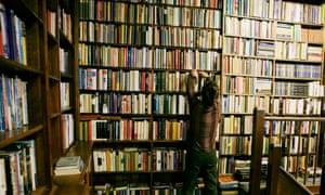 Man looking at books in Hall's bookstore, Tunbridge Wells