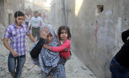 Syrians look for relatives after what local sources said was an airstrike by Russian forces near Aleppo.
