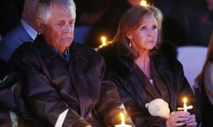 Carl and Marsha Mueller hold candles at a memorial for their daughter in 2015