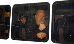 Julian Assange is seen in a police van after was arrested by British police outside the Ecuadorian embassy in London