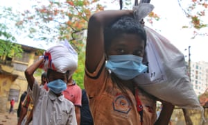 Children return back home after receiving relief supplies during the lockdown in Dhaka, Bangladesh .