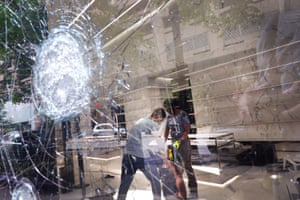 Workers clean up inside of the Saint Laurent store after it was looted on 10 August in Chicago.