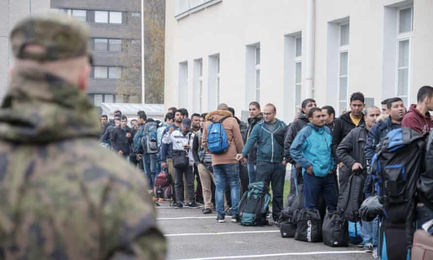 Refugees queue up as they arrive at a reception centre in Tornio, Finland.