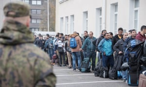 Asylum seekers queue at a refugee reception centre in the town of Tornio, northern Finland, in September 2015