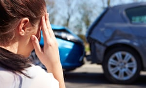 driver sitting at roadside after traffic accident