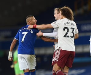 Luiz and Holding try to hurry Richarlison off the pitch.