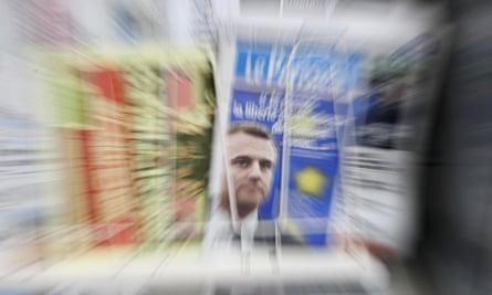 Newspaper headlines on French president Emmanuel Macron's column.