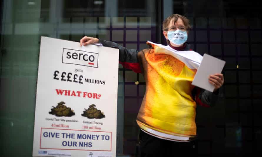 A campaigner outside the Department of Health and Social Care in London.