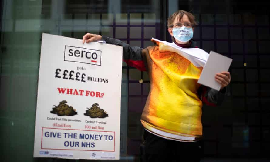 Demonstrator at a protest against Serco's handling of the test-and-trace system at the Department of Health and Social Care in London