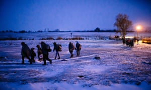 Refugees cross the Macedonian border into Serbia on Sunday. Milos Zeman said integration only works with certain cultures, citing the Vietnamese community.