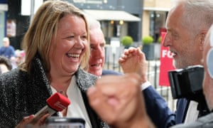 Labour's newly elected MP Lisa Forbes celebrates with Jeremy Corbyn in Peterborough city centre