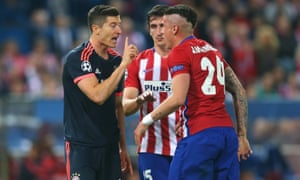 Jose Gimenez of Atletico Madrid and Robert Lewandowski lets Jose Gimenez know what he thinks of his exaggeration.
