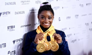 Simone Biles with the five gold medals from a possible six that she won at the world championships in Stuttgart.
