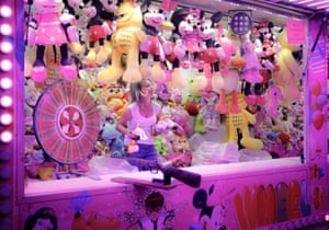 A woman holds toys at her stall in Roşiorii de Vede