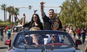 Andy Ruiz Jr and his wife, Julie, wave to a cheering crowd at a parade in his honor in Imperial, California