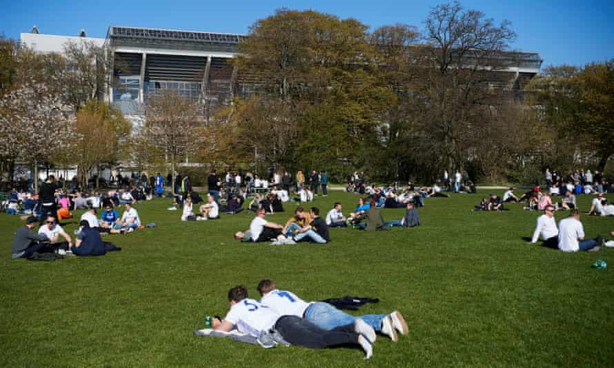 Fans relax before a match at the Parken Stadium.