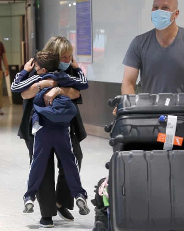 Sue Blake embraces her grandson at Heathrow.