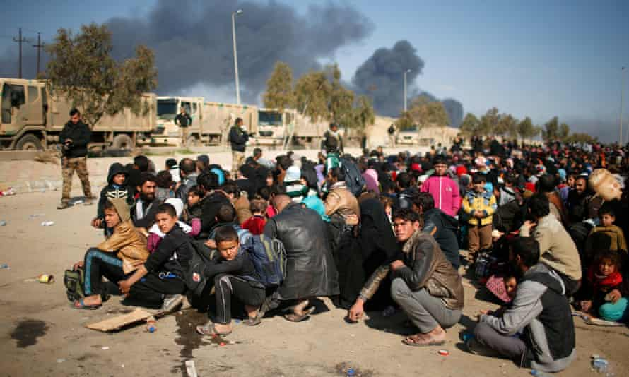 Displaced Iraqis flee their homes in Mosul.