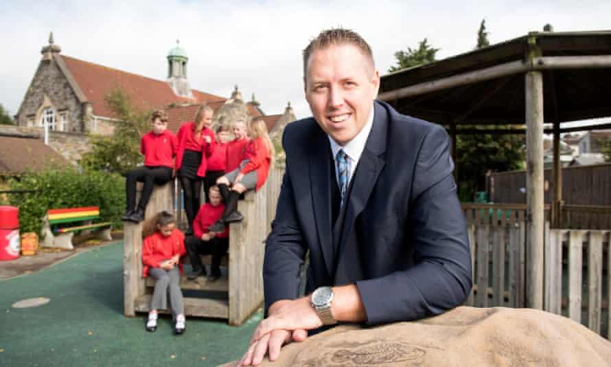Jamie Barry in playground with children in background
