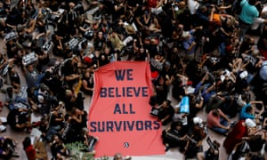 Activists hold a protest march and rally in opposition to supreme court nominee Brett Kavanaugh on Capitol Hill in Washington on 4 October.